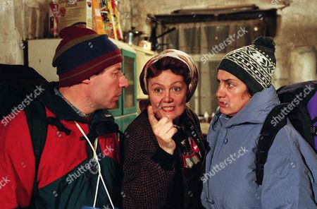 Stock Photo of Two campers on a working holiday researching local customs for their historical societ arrive at the Dingles Wishing Well Cottage. Nellie makes a fuss of them, but they are petrified to find Sam brandishing a bloody meat cleaver - With Nellie Dingle, as played by Sandra Gough ; Rusty Hislop, as played by Cliff Howells; and Denise Hislop, as played by Phillippa Howell. (Ep 2030 - 28th November 1995).