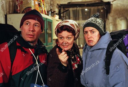 Two campers on a working holiday researching local customs for their historical societ arrive at the Dingles Wishing Well Cottage. Nellie makes a fuss of them, but they are petrified to find Sam brandishing a bloody meat cleaver - With Nellie Dingle, as played by Sandra Gough ; Rusty Hislop, as played by Cliff Howells; and Denise Hislop, as played by Phillippa Howell. (Ep 2030 - 28th November 1995).