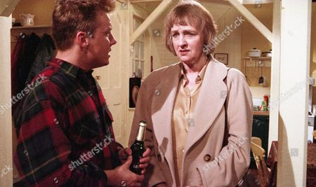 Caroline arrives in Emmerdale and wants to know what has been going on. Nick tells her about Dave's affair with Kim and she is shocked. She agrees not to say anything to Kathy - With Nick Bates, as played by Cy Chadwick, and Caroline Bates, as played by Diana Davies. (Ep 2025 - 9th November 1995).