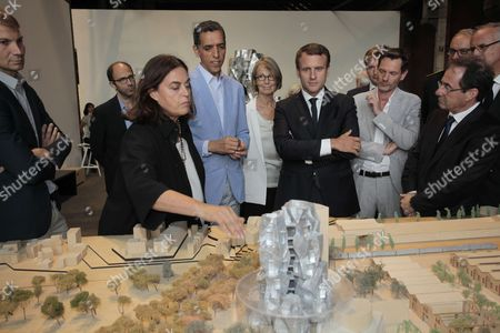 French President Emmanuel Macron (C) listens to Executive Director of the LUMA Foundation, Mustapha Bouhayati (2ndL) during a visit with Executive Director of LUMA Arles and President of the LUMA Foundation, Maja Hoffmann (L) to the LUMA Arles Foundation in Arles on July 19, 2017, as prefect of the Provence-Alpes-Cote d'Azur region, Stephane Bouillon (R), French Culture Minister, Francoise Nyssen (3rdL), Arles mayor Herve Schiavetti (2ndR) and President of the Executice Committee of the 'Rencontres d'Arles' annual photographic festival, Hubert Vedrine (Rear C) look on