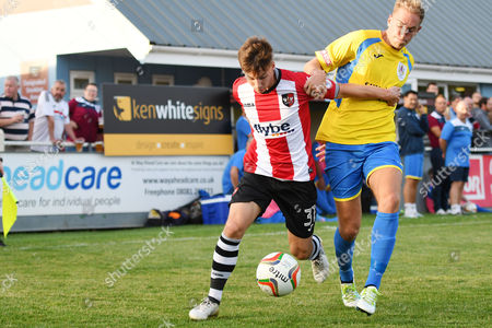 Stock Image of Kyle Egan of Exeter City competes for the ball with Ben Palmer of Taunton Town, during the pre season friendly match between Taunton Town and Exeter City, on Thursday 20th July 2017 at The Viridor Stadium, Taunton, Somerset