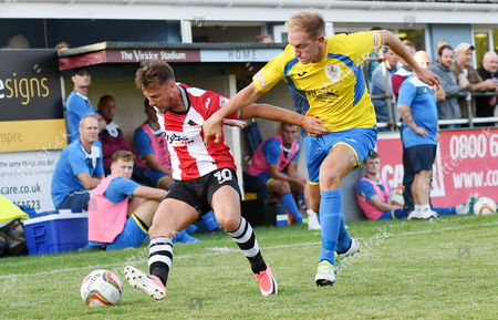 Lee Holmes of Exeter City competes for the ball with Ben Palmer of Taunton Town, during the pre season friendly match between Taunton Town and Exeter City, on Thursday 20th July 2017 at The Viridor Stadium, Taunton, Somerset