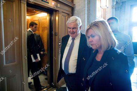Former House Speaker Newt Gingrich, R-Ga., walks on Capitol Hill, in Washington