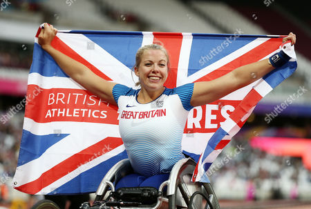 Hannah Cockroft of Great Britain celebrates after winning gold in the Womens 400m T34 Final and her third gold of the Championships.