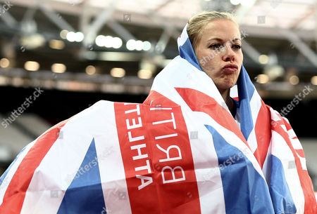 Hannah Cockroft of Great Britain celebrates and pouts after winning gold in the Womens 400m T34 Final and her third gold of the Championships.