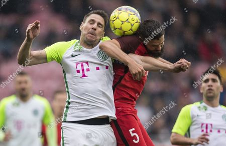 Stock Image of Marc Dal Hende (R) of FC Midtjylland in action against Zoltan Gera of Ferencvaros during the UEFA Europa League second qualifying round, 2nd leg match between FC Midtjylland and Ferencvaros in Herning, Denmark, 20 July 2017.