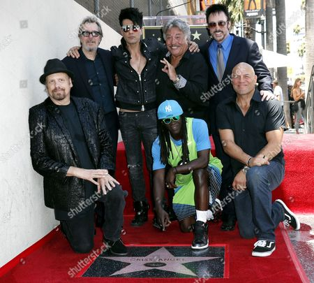 US illusionist Criss Angel (BACK 2L) is joined by British actor Gary Oldman (BACK L), US singer Tony Orlando (BACK 2R), US magician Lance Burton (BACK R), US magician The Amazing Johnathan (FRONT L), US singer Flavor Flav (FRONT C) and  and US actor/fighter Randy Couture (FRONT R) for a picture following Angel's star ceremony on the Hollywood Walk of Fame in Hollywood, California, USA 20 July 2017.  Angel received the 2,615th star on the Walk of Fame in the category of Live Performance.