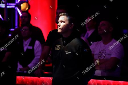 Ben Lamb watches before he is knocked out of the main event of the World Series of Poker, in Las Vegas. Lamb finished in ninth place