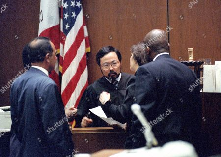 Superior Court Judge Lance Ito, center, listens to prosecutor Marcia Clark, center right, during a bench conference in the middle of the trial of former NFL star running back O.J. Simpson for the murder of his former wife, Nicole Brown Simpson and a friend of hers, restaurant waiter, Ron Goldman in Los Angeles County Superior Court in Los Angeles, California on July 13, 1995. From left to right: Defense Attorney Robert Shapiro, Judge Ito, Clark, and prosecutor Christopher Darden.