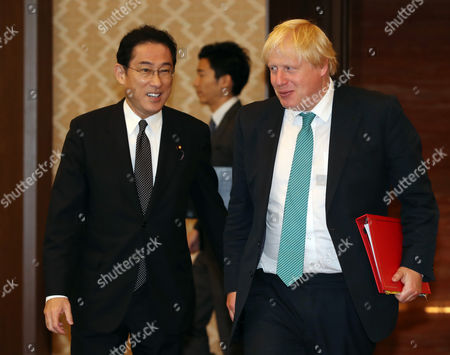 British Foreign Secretary Boris Johnson (R) is greeted by his Japanese counterpart Fumio Kishida for their talks at the Iikura guesthouse in Tokyo