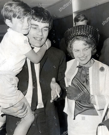 Jimmy Nicol Former Drummer Who Is Known As The Fifth Beatle After He Replaced A Tonsillitis Stricken Ringo Starr On The Beatles 1964 World Tour Is Pictured With His Son Howard And His Mother On His Return To Heathrow From Australia.