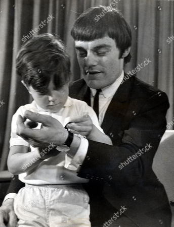 Jimmy Nicol Former Drummer Who Is Known As The Fifth Beatle After He Replaced A Tonsillitis Stricken Ringo Starr On The Beatles 1964 World Tour Is Pictured With His Son Howard On His Return To Heathrow From Australia After Starr Rejoined The Band.