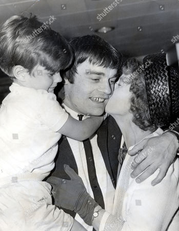 Jimmy Nicol Former Drummer Who Is Known As The Fifth Beatle After He Replaced A Tonsillitis Stricken Ringo Starr On The Beatles 1964 World Tour Is Pictured With His Son Howard And His Mother On His Return To Heathrow Ringo Rejoined The Band.
