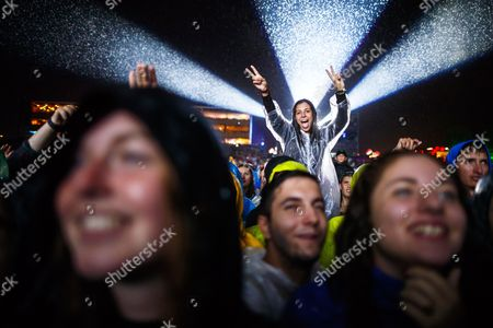 Festival goers cheer under the rain during the performance of Alpha Diallo, aka Black M, on the main stage at the 42nd Paleo Festival, in Nyon, Switzerland, 21 July 2017 (issued 22 July 2017). The event runs from July 18 to 23. The Paleo Festival de Nyon, is an annual rock music festival.