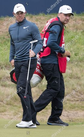Stock Image of Rory McIlroy on 18th Green with his caddie JP Fitzgerald