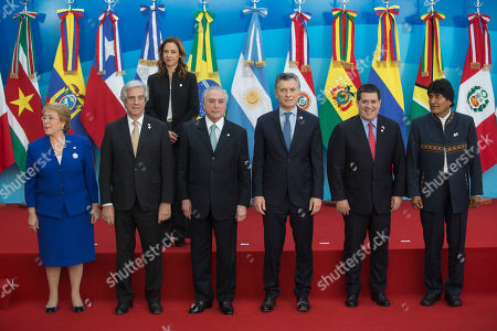 Michelle Bachelet, Tabare Vazquez, Michel Temer, Mauricio Macri, Horacio Cartes, Evo Morales, Maria Claudia Lacouture Heads of state from left to right; Chile's President Michelle Bachelet; Uruguay's President Tabare Vazquez; Brazil's President Michel Temer; Argentina's President Mauricio Macri; Paraguay's President Horacio Cartes and Bolivia's President Evo Morales, pose for a group photo at the Mercosur Summit in Mendoza, Argentina, . Pictured in the back row is Colombia's Tourism and Industry Minister Maria Claudia Lacouture