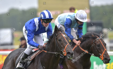 Stock Picture of (L) Alkhalifa (Jim Crowley) wins The bet365 Novice Stakes from (R) Oliver Reed (Ryan Moore) at Newbury Racecourse on Saturday 22nd July 2017.