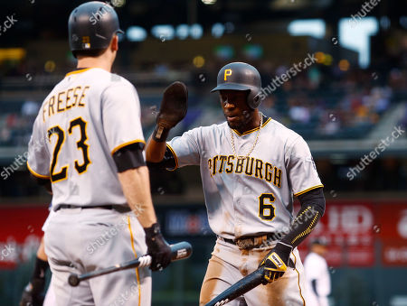 David Freese, Starling Marte Pittsburgh Pirates' David Freese, left, congratulates Starling Marte after Marte scored on a single by Josh Bell off Colorado Rockies starting pitcher Jeff Hoffman in the first inning of a baseball game, in Denver