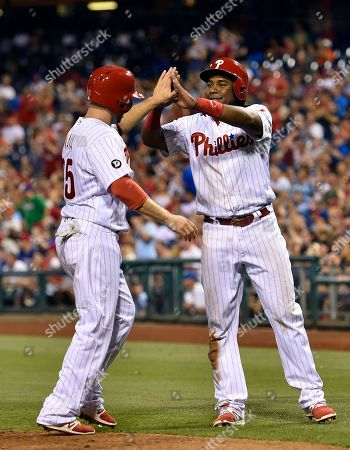 Maikel Franco, Daniel Nava Philadelphia Phillies' Maikel Franco, right, high-fives Daniel Nava after they scored on a Tommy Joseph double off Milwaukee Brewers' Carlos Torres during the sixth inning of a baseball game, in Philadelphia