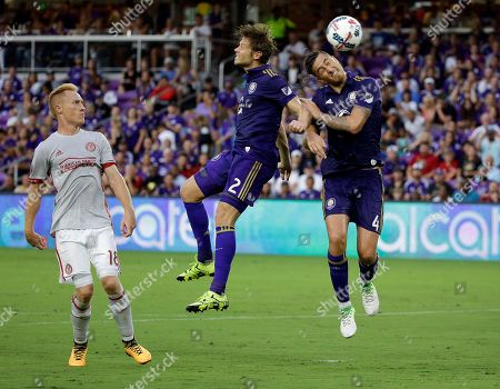 Jonathan Spector, Jose Aja, Jeff Larentowicz Orlando City's Jonathan Spector (2) and Jose Aja (4) try to head the ball to the goal in front of Atlanta United's Jeff Larentowicz (18) on a corner kick during the first half of an MLS soccer match, in Orlando, Fla
