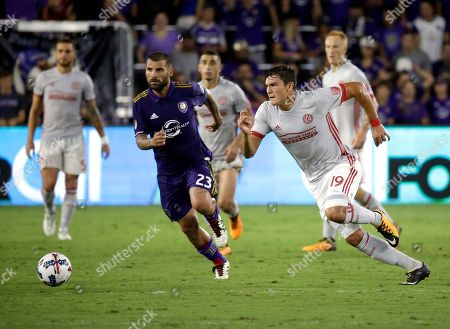 Atlanta United's Brandon Vazquez (19) and Orlando City's Antonio Nocerino (23) fight for possession of the ball during the second half of an MLS soccer match, in Orlando, Fla. Atlanta United won 1-0