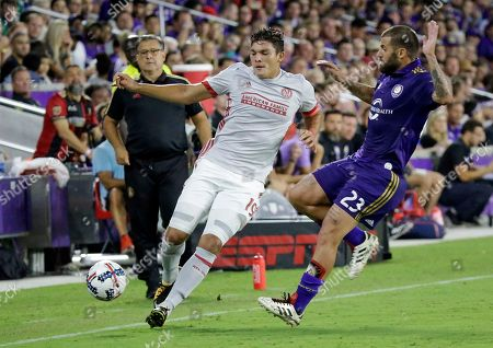 Atlanta United's Brandon Vazquez, left, and Orlando City's Antonio Nocerino (23) fight for possession of the ball during the second half of an MLS soccer match, in Orlando, Fla. Atlanta United won 1-0