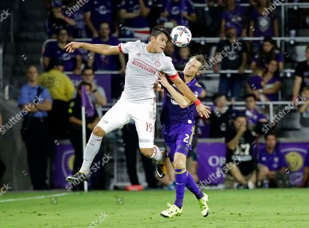 Brandon Vazquez, Jonathan Spector Atlanta United's Brandon Vazquez (19) heads the ball away from Orlando City's Jonathan Spector (2) during the second half of an MLS soccer match, in Orlando, Fla. Atlanta United won 1-0