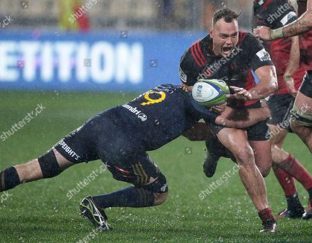 Crusaders Israel Dagg is tackled by Highlanders Alex Ainley during their Super Rugby quarterfinal in Christchurch, New Zealand, .The Crusaders defeated the Highlanders 17-0