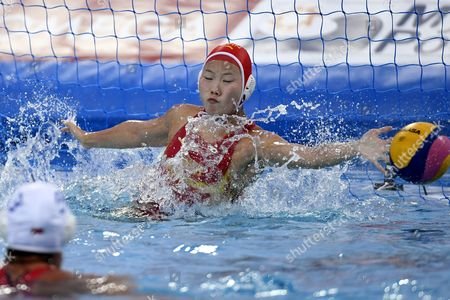 Stock Photo of Chinese goalkeeper Lin Peng in action during their women's water polo China vs Spain match for qualifying in the group of best eight at the 17th FINA Swimming World Championships in Hajos Alfred National Swimming Pool in Budapest, Hungary, 22 July 2017.