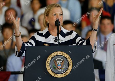 Daughter of former President Gerald Ford, Susan Ford-Bales, gives the command for the ship to come alive aboard the nuclear aircraft carrier USS Gerald R. Ford for it's commissioning at Naval Station Norfolk in Norfolk, Va