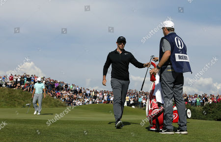 Stock Photo of Northern Ireland's Rory McIlroy hands his putter to his caddie JP Fitzgerald after his birdie on the 9th hole during the third round of the British Open Golf Championship, at Royal Birkdale, Southport, England