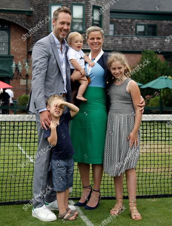 Kim Clijsters, Brian Lynch Tennis Hall of Fame inductee Kim Clijsters of Belgium poses with her husband, Brian Lynch, and their children, Jada, right, Jack, left, and baby Blake during enshrinement ceremonies at the International Tennis Hall of Fame, in Newport, R.I