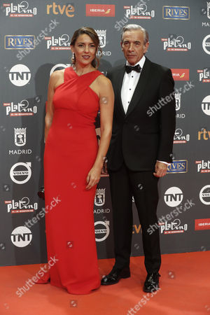 Spanish actor Imanol Arias (R) and his partner Irene Meritxell pose as they arrive at the 4th Ibero American Cinema Platino Awards ceremony at the Magic Box in Madrid, Spain, 22 July 2017.
