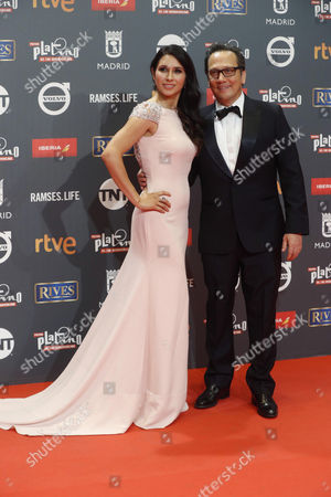 Stock Image of US actor Rob Schneider (R) and his wife Patricia Maya pose as they arrive at the 4th Ibero American Cinema Platino Awards ceremony at the Magic Box in Madrid, Spain, 22 July 2017.