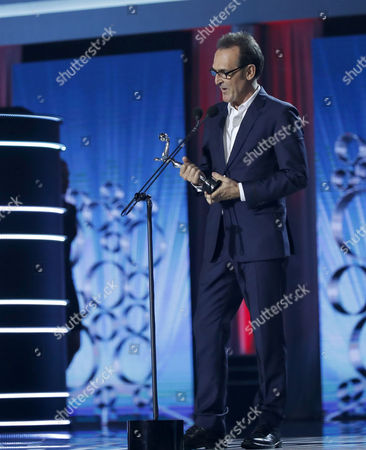 Spanish composer Alberto Iglesias receives the Platino Award for 'Best Original Music' for 'Julieta' during the 4th Ibero American Cinema Platino Awards ceremony at the Magic Box in Madrid, Spain, 22 July 2017.