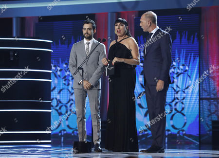(L-R) Actors Luis Gerardo Mendez, Rossy De Palma and Dario Grandinetti during the 4th Ibero American Cinema Platino Awards ceremony at the Magic Box in Madrid, Spain, 22 July 2017.