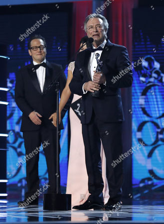 Argentinian actor Oscar Martinez (L) receives the Platino Award to 'Best Male Performance' for 'El ciudadano ilustre' from US actor Rob Schneider during the 4th Ibero American Cinema Platino Awards ceremony at the Magic Box in Madrid, Spain, 22 July 2017.