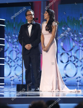 US actor Rob Schneider and his wife Patricia Mayra (R) during the 4th Ibero American Cinema Platino Awards ceremony at the Magic Box in Madrid, Spain, 22 July 2017.