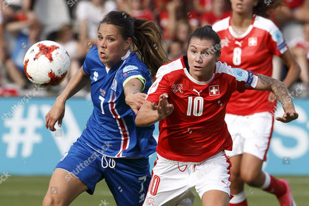 Iceland's midfielder Sara Bjork Gunnarsdottir, left, fights for the ball with Switzerland's forward Ramona Bachmann, right, during the UEFA Women's Euro 2017 group C preliminary round match between Iceland and Switzerland, at the De Vijverberg stadium, in Doetinchem, The Netherlands, Saturday, July 22, 2017.