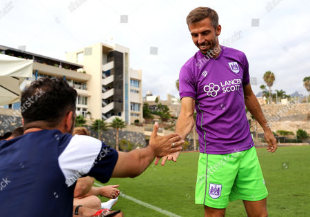 Stock Photo of Gary O'Neil shakes hands with coach Scott Murray before entering as a sub