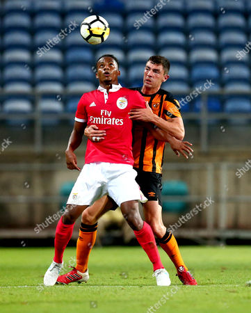 Andre Carrillo of Benfica battles with Brian Lenihan of Hull City