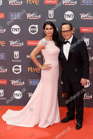 Patricia Azarcoya, Rob Schneider US actor Rob Schneider, right, and his wife Patricia Azarcoya pose for photographers on the red carpet of the Platino Awards ceremony in Madrid