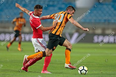 Benfica's Goncalves (L)  fighting for the ball together with Hull City oponent Brian Lenihan during their friendly match at the Algarve stadium in Loule, South Portugal, 22 July 2017.