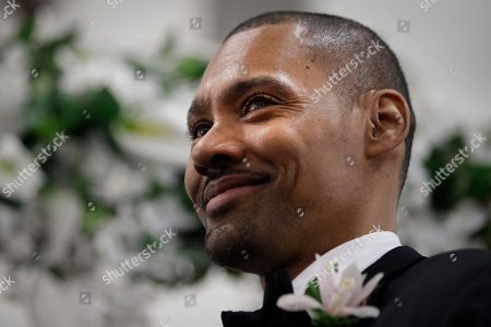 Tears well up in the eyes of Two-time Olympic jumper Jamie Nieto, who was paralyzed from neck down 15 months ago after a spinal cord injury, as he watches his bride Shevon Stoddart walk up the aisle toward him during their wedding ceremony, in El Cajon, Calif. The two-time Olympic high jumper successfully walked down the aisle under his own power at his wedding to the Jamaican hurdler