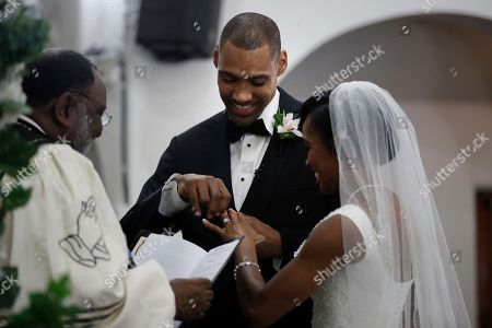 Jamie Nieto, Shevon Stoddart Two-time Olympic jumper Jamie Nieto, center, who was paralyzed from neck down 15 months ago after a spinal cord injury, smiles as he struggles with putting a ring on the finger of his bride Shevon Stoddart during a wedding ceremony, in El Cajon, Calif. Step by halting step, Nieto made good on his vow to walk his new wife down the aisle of the church and out the door to a waiting limousine