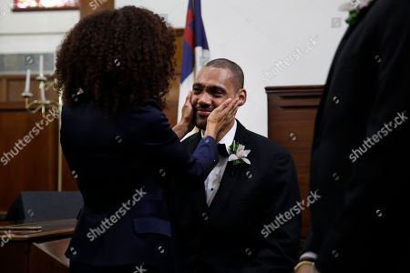 Two-time Olympic jumper Jamie Nieto, who was paralyzed from neck down 15 months ago after a spinal cord injury, sheds tears while greeting a guest at his wedding with Jamaican hurdler Shevon Stoddart, in El Cajon, Calif. Step by halting step, Nieto made good on his vow to walk his new wife down the aisle of the church and out the door to a waiting limousine
