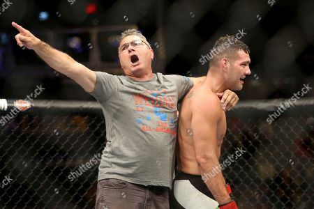 Chris Weidman, Charlie Weidman Chris Weidman celebrates a win against Kelvin Gastelum with his father Charlie during their mixed martial arts bout at UFC on Fox 25, in New York. Weidman won via 3rd round submission