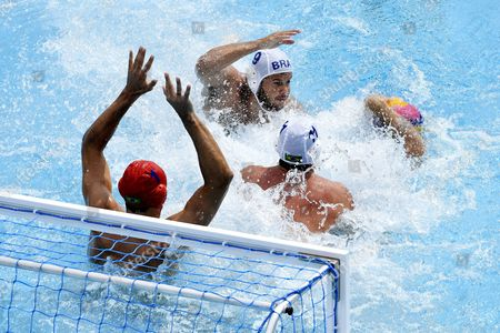 Lachlan Edwards of Australia (R) in action against Gustavo Guimaraes (11), Bernardo Rocha (9) and goalkeeper Slobodan Soro (L) of Brazil during the men's water polo Australia vs Brazil match for qualifying in the group of eight best teams of the 17th FINA Swimming World Championships in Hajos Alfred National Swimming Pool in Budapest, Hungary, 23 July 2017.