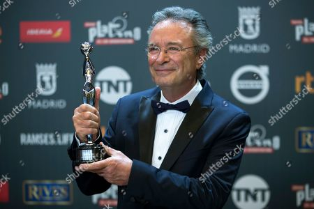 Argentinian actor Oscar Martinez poses for photographers after winning the best actor award during the Platino Awards ceremony in Madrid, early. The Platino Awards honor cinema produced in Latin America, Spain and Portugal