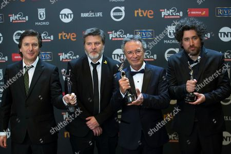 "Oscar Martinez, Andres Duprat, Marino Cohn, Gaston Duprat Best screenwriter awardee Andres Duprat, left, best actor recipient Oscar Martinez, second from right, and best film co-directors Gaston Duprat, second left, and Marino Cohn, right, pose with their awards for their roles in the film ""El ciudadano ilustre"" during the Platino Awards ceremony in Madrid, early. The Platino Awards honor cinema produced in Latin America, Spain and Portugal"